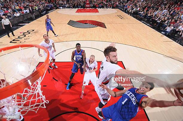 Michael CarterWilliams of the Philadelphia 76ers drives to the basket and gets his shot blocked by Joel Freeland of the Portland Trail Blazers on...