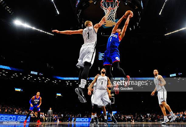 Michael CarterWilliams of the Philadelphia 76ers dunks over Mason Plumlee of the Brooklyn Nets in the second half at the Barclays Center on December...