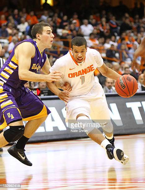 Michael CarterWilliams of the Syracuse Orange drives the ball down the court against Logan Aronhalt of the Albany Great Danes during the NIT Season...