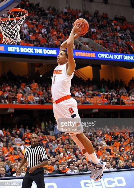 Michael CarterWilliams of the Syracuse Orange dunks the ball during the game against the Monmouth Hawks at the Carrier Dome on December 8 2012 in...