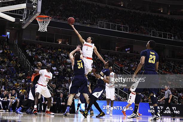 Michael CarterWilliams of the Syracuse Orange goes up over Robert Thurman of the California Golden Bears in the first half during the third round of...