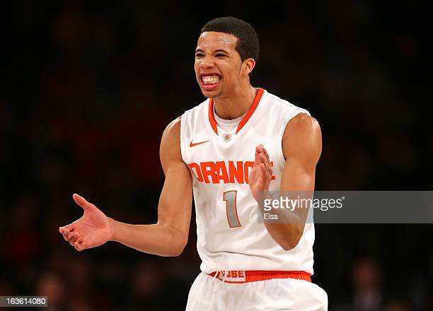 Michael CarterWilliams of the Syracuse Orange reacts after a play in the second half against the Seton Hall Pirates during the second round of the...