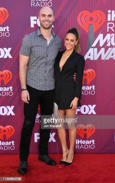 Michael Caussin and Jana Kramer attend the 2019 iHeartRadio Music Awards which broadcasted live on FOX at Microsoft Theater on March 14, 2019 in Los...