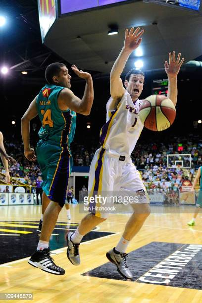 Michael Cedar of the Crocodiles contests the ball with Ben Madgen of the Kings during the round 20 NBL match between the Townsville Crocodiles and...