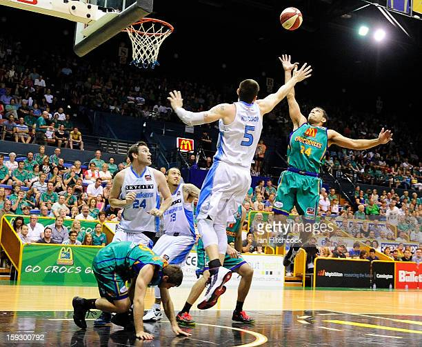 Michael Cedar of the Crocodiles contests the ball with Will Hudson of the Breakers s during the round 14 NBL match between the Townsville Crocodiles...