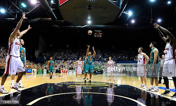 Michael Cedar of the Crocodiles shoots the game winning point during the round nine NBL match between the Townsville Crocodiles and the Wollongong...