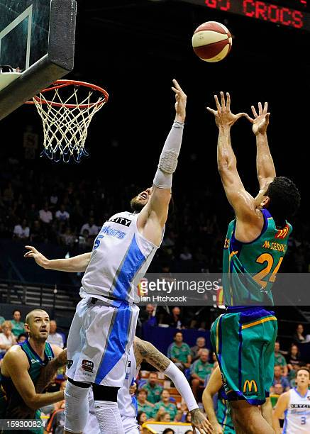 Michael Cedar of the Crocodilescontests the ball with Will Hudson of the Breakers during the round 14 NBL match between the Townsville Crocodiles and...