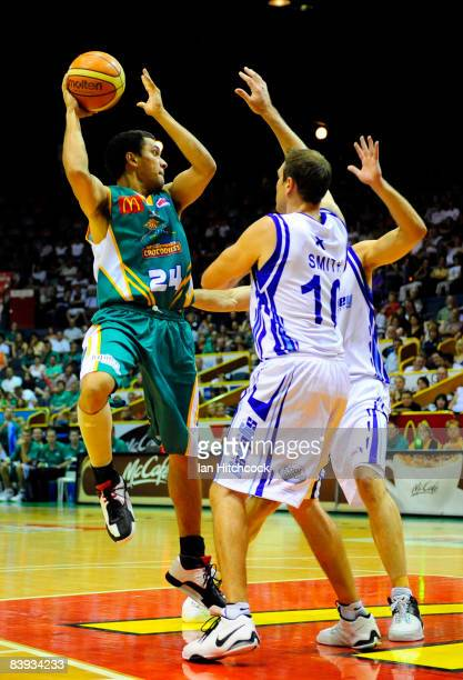 Michael Cedar of the Crocs looks to get a pass away despite the Spirit defence during the round 12 NBL match between the Townsville Crocodiles and...