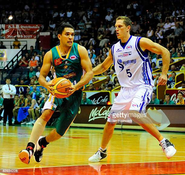 Michael Cedar of the Crocslooks to get past Graeme Dann of the Spirirt during the round 12 NBL match between the Townsville Crocodiles and the Sydney...