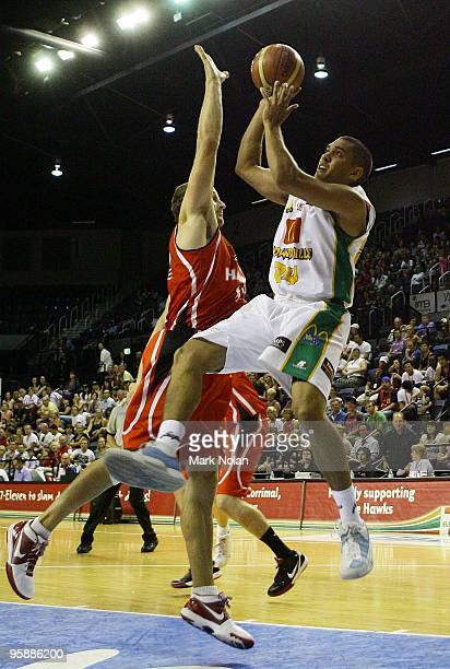 Michael Cedar of Townsville drives to the basket during the round 17 NBL match between the Wollongong Hawks and the Townsville Crocodiles at...