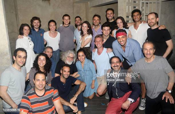 Michael Cera wife Nadine and Lucas Hedges pose with the cast backstage at the hit musical 'The Bands Visit' on Broadway at The Barrymore Theater on...