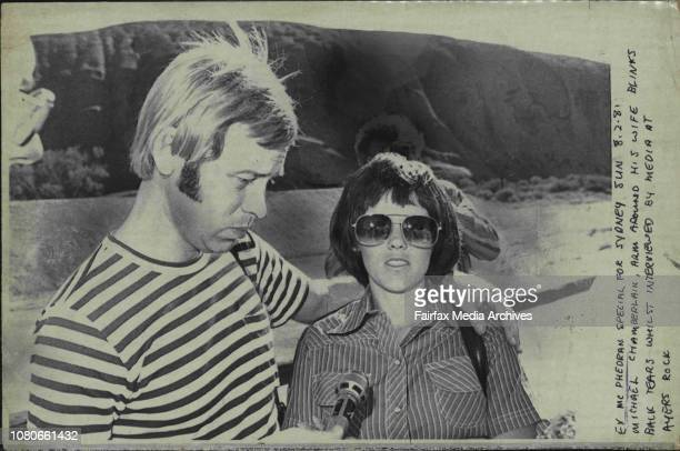 Michael Chamberlain, arm around his wife blinks back tears whilst interviewed by media at Ayers Rock. February 8, 1981. .