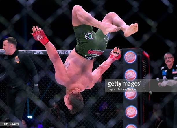 Michael Chandler Jr does a backflip in the cage as he celebrates after defeating Goiti Yamauchi in their Lightweight fight at Bellator 192 at The...