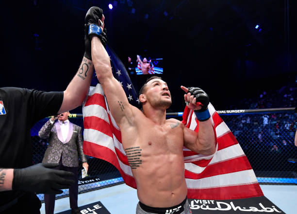 Michael Chandler reacts after his knockout victory over Dan Hooker of New Zealand in a lightweight fight during the UFC 257 event inside Etihad Arena...
