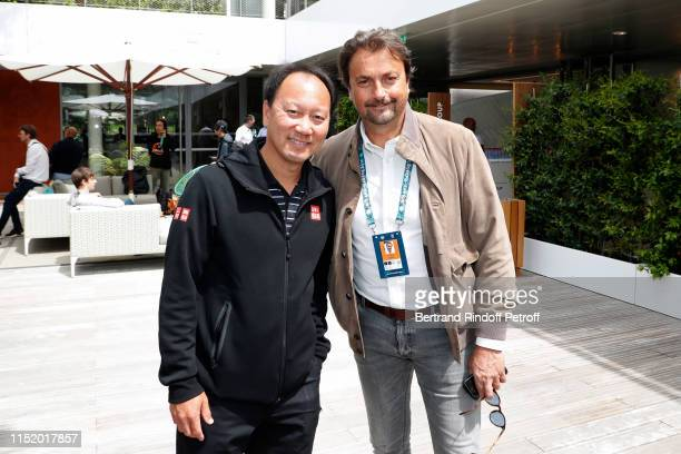 Michael Chang and Henri Leconte attend the 2019 French Tennis Open Day Two at Roland Garros on May 27 2019 in Paris France