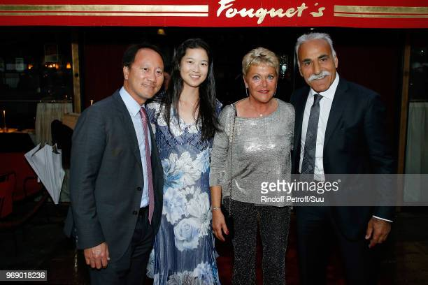 """Michael Chang and his wife Amber Liu, Frederique Bahrami and Mansour Bahrami attend """"Diner des Legendes"""" at Le Fouquet's on June 6, 2018 in Paris,..."""