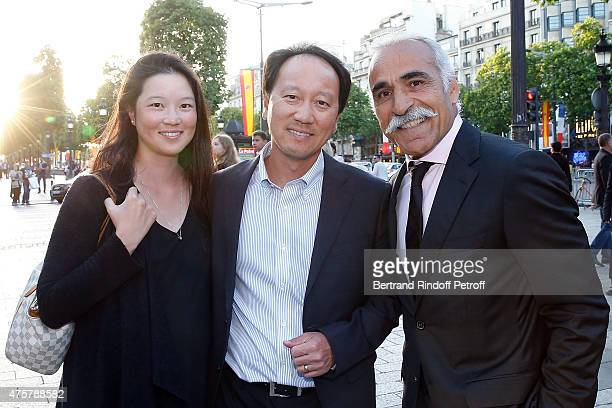 Michael Chang and his wife Amber Liu with Mansour Bahrami attend the Trophee des Legendes Dinner at Le Fouquet's champs Elysees on June 3 2015 in...