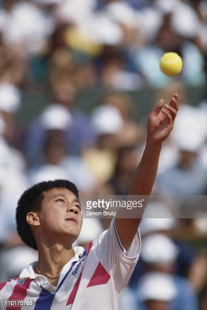 Michael Chang of the United States keeps his eyes on the ball as he prepares to serve to Stefan Edberg during the Men's Singles final match at the...