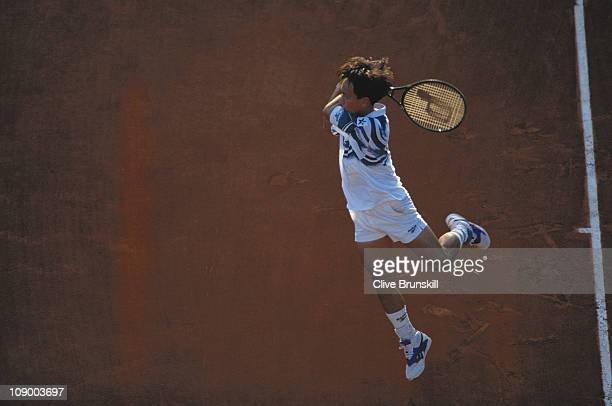 Michael Chang of the United States powers a return against Jaime Yzaga in their third round Men's Singles match during the French Open Tennis...