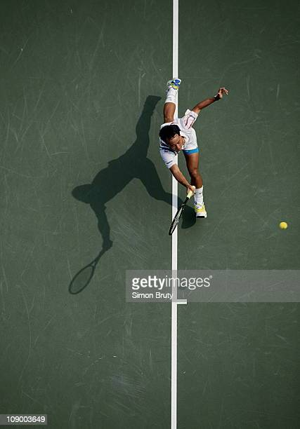 Michael Chang of the United States races his shadow ouitstretched down the baseline during his Men's Singles match against Patrick McEnroe at the...