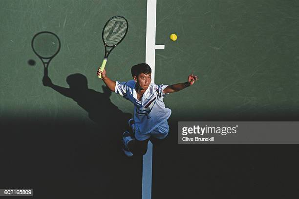 Michael Chang of the United States serves to Andre Agassi during the Men's Singles fourth round match of the United States Open Tennis Championship...