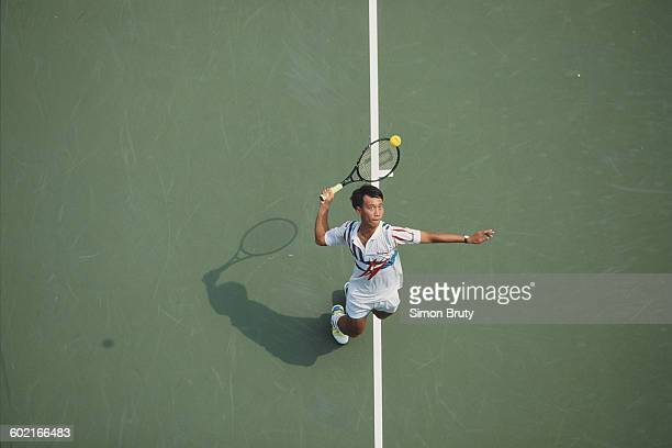 Michael Chang of the United States serves to Wayne Ferreira during the Men's Singles Quarter Final match of the United States Open Tennis...
