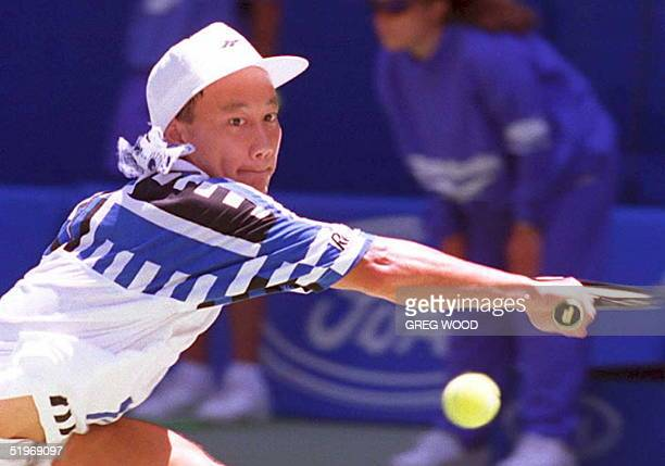 Michael Chang of the US stretches for a backhand during his quarterfinal match against Andrei Medvedev of the Ukraine at the Australian Open 24...