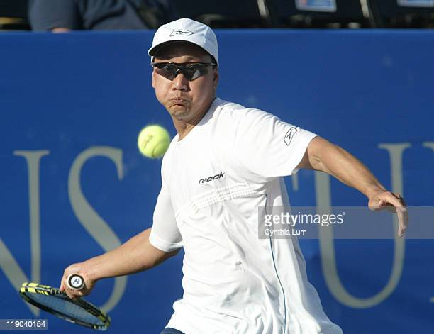 Michael Chang of the USA in action before he has to default the match to Mikael Pernfors of Sweden after suffering an achilles tendon injury at the...