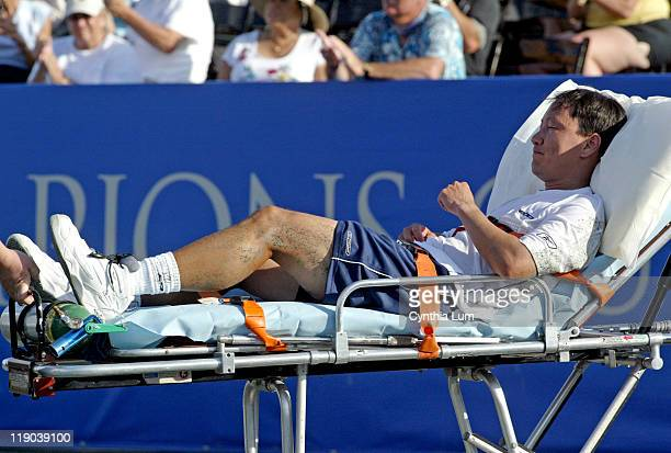 Michael Chang of the USA is taken off the court on a stretcher after he suffers an achilles tendon injury in the second set of their second round...