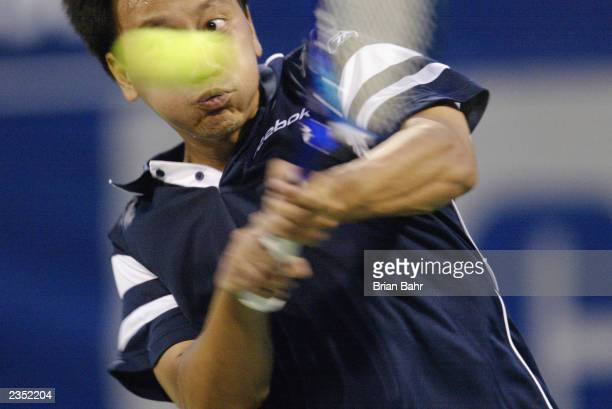 Michael Chang returns a shot to Eric Taino during the RCA Championships at the Indianapolis Tennis Center on July 21 2003 in Indianapolis Indiana...