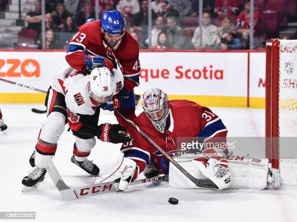 Michael Chaput of the Montreal Canadiens defends against Colin White of the Ottawa Senators while goaltender Carey Price makes a save during the NHL...