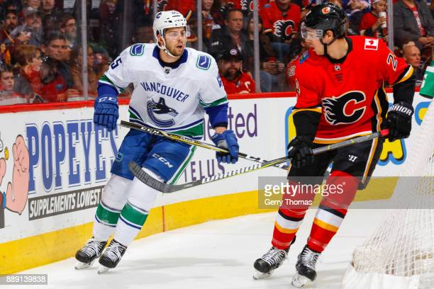 Michael Chaput of the Vancouver Canucks and Travis Hamonic of the Calgary Flames in a NHL game against the Vancouver Canucks at the Scotiabank...