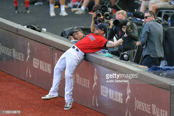 Michael Chavis of the Boston Red Sox attempts a catch a foul in front of photographers during the MLB London Series game between the New York Yankees...