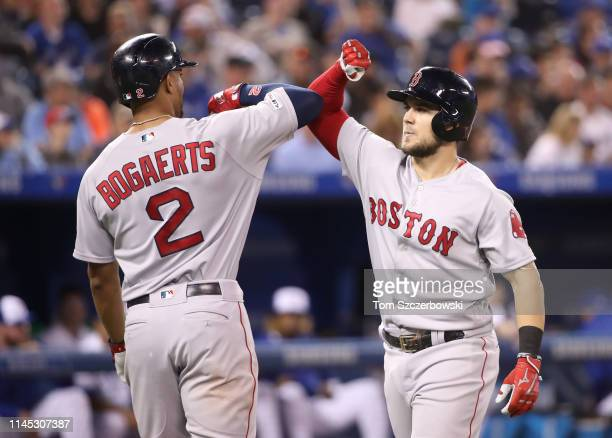Michael Chavis of the Boston Red Sox is congratulated by Xander Bogaerts after hitting a two-run home run in the third inning during MLB game action...