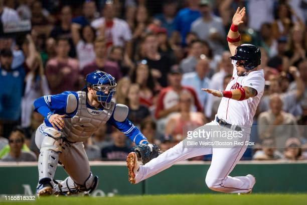 Michael Chavis of the Boston Red Sox is tagged out by Danny Jansen of the Toronto Blue Jays during the sixth inning of a game on July 15 2019 at...