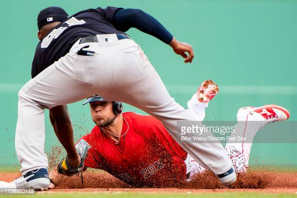 Michael Chavis of the Boston Red Sox is tagged out by Miguel Andujar of the New York Yankees during the second inning of a game on February 23, 2019...