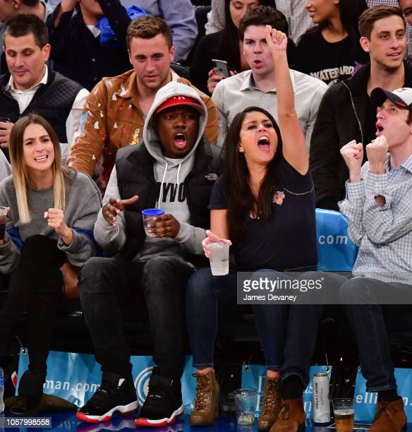 Michael Che and Cecily Strong attend the Chicago Bulls vs New York Knicks game at Madison Square Garden on November 5 2018 in New York City