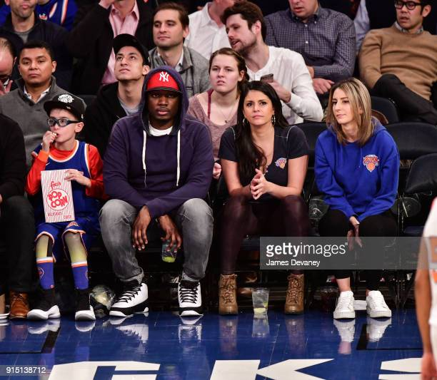 Michael Che and Cecily Strong attend the New York Knicks vs Milwaukee Bucks game at Madison Square Garden on February 6 2018 in New York City
