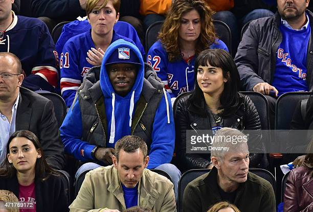 Michael Che and guest attend the Washington Capitals vs New York Rangers playoff game at Madison Square Garden on April 30 2015 in New York City