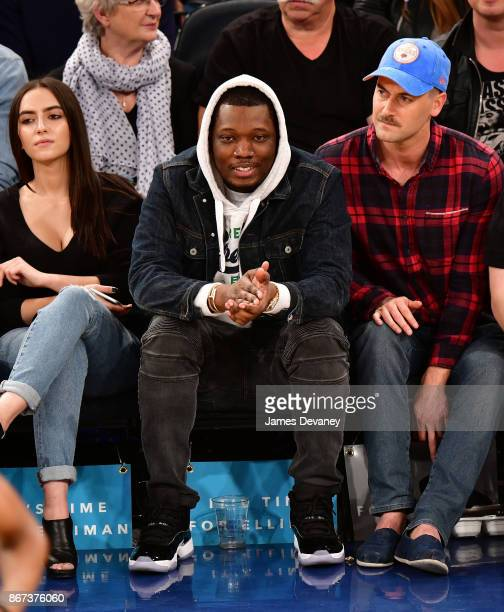 Michael Che and Ryan Eggold attend the Brooklyn Nets Vs New York Knicks game at Madison Square Garden on October 27 2017 in New York City