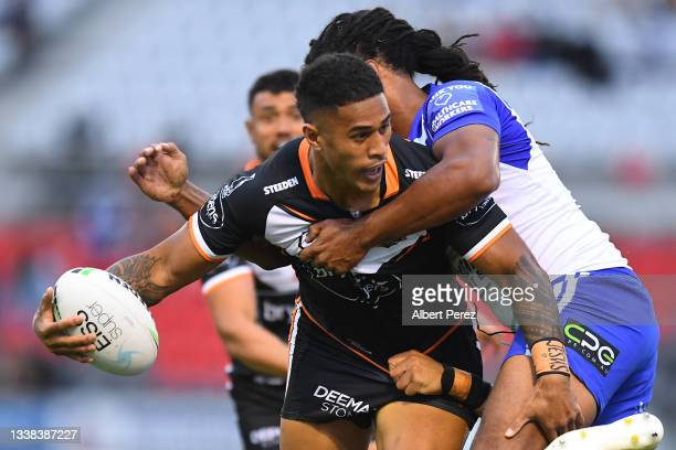 Michael Chee Kam of the Tigers is tackled during the round 25 NRL match between the Wests Tigers and the Canterbury Bulldogs at Moreton Daily...
