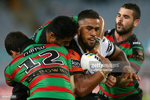 Michael Chee Kam of the Tigers is tackled during the round nine NRL match between the South Sydney Rabbitohs and the Wests Tigers at ANZ Stadium on...