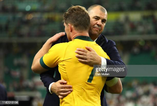 Michael Cheika, Head Coach of Australia and Michael Hooper of Australia embrace following the Rugby World Cup 2019 Quarter Final match between...