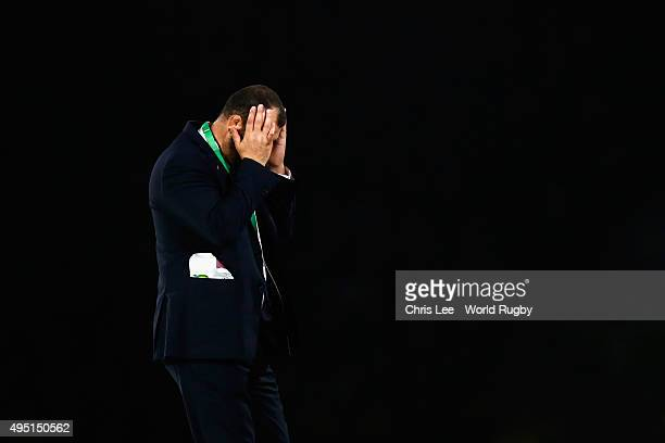 Michael Cheika Head Coach of Australia heads his head in dejected during the post match presentations after the 2015 Rugby World Cup Final match...