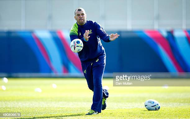 Michael Cheika, Head Coach of Australia passes the ball during a training session at Dulwich College on October 1, 2015 in London, United Kingdom.