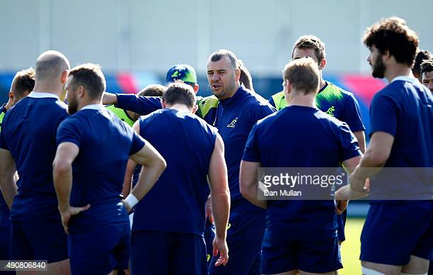 Michael Cheika, Head Coach of Australia talks to his players during a training session at Dulwich College on October 1, 2015 in London, United...