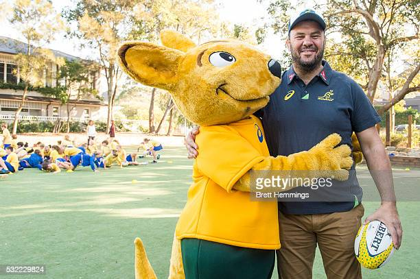 Michael Cheika interacts with the Wallabies mascot after announching his extention as Wallabies coach until 2019 during an ARU Game On event at...
