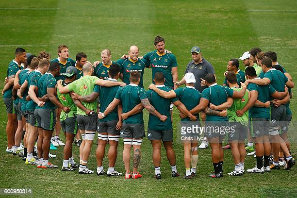 Michael Cheika talks to players during the Australian Wallabies captain's run at Ballymore Stadium on September 9 2016 in Brisbane Australia