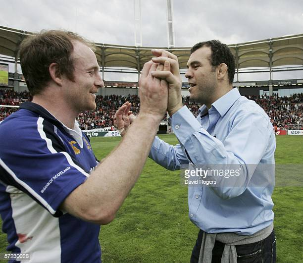 Michael Cheika the Leinster coach celebrates with Denis Hickie after their victory in the Heineken Cup match between Toulouse and Leinster at Stade...