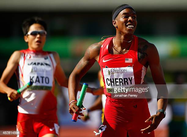 Michael Cherry of the US celebrates as he crosses the finish line ahead of Nobuya Kato of Japan to win the gold medal in the men's 4x400m relay final...